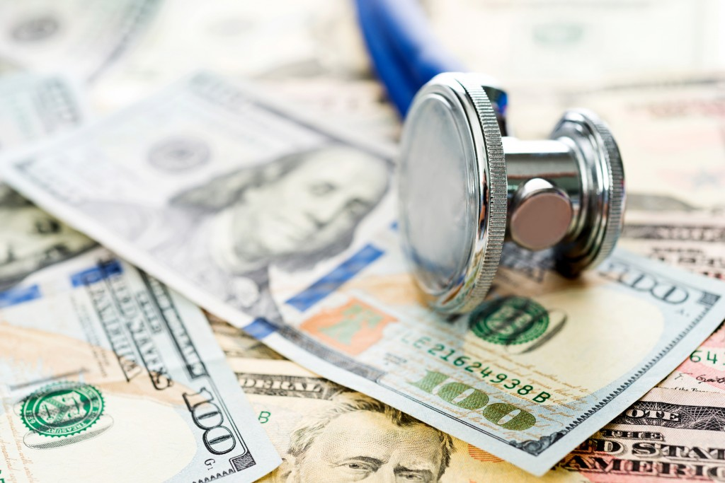 Stethoscope over the dollar bills.